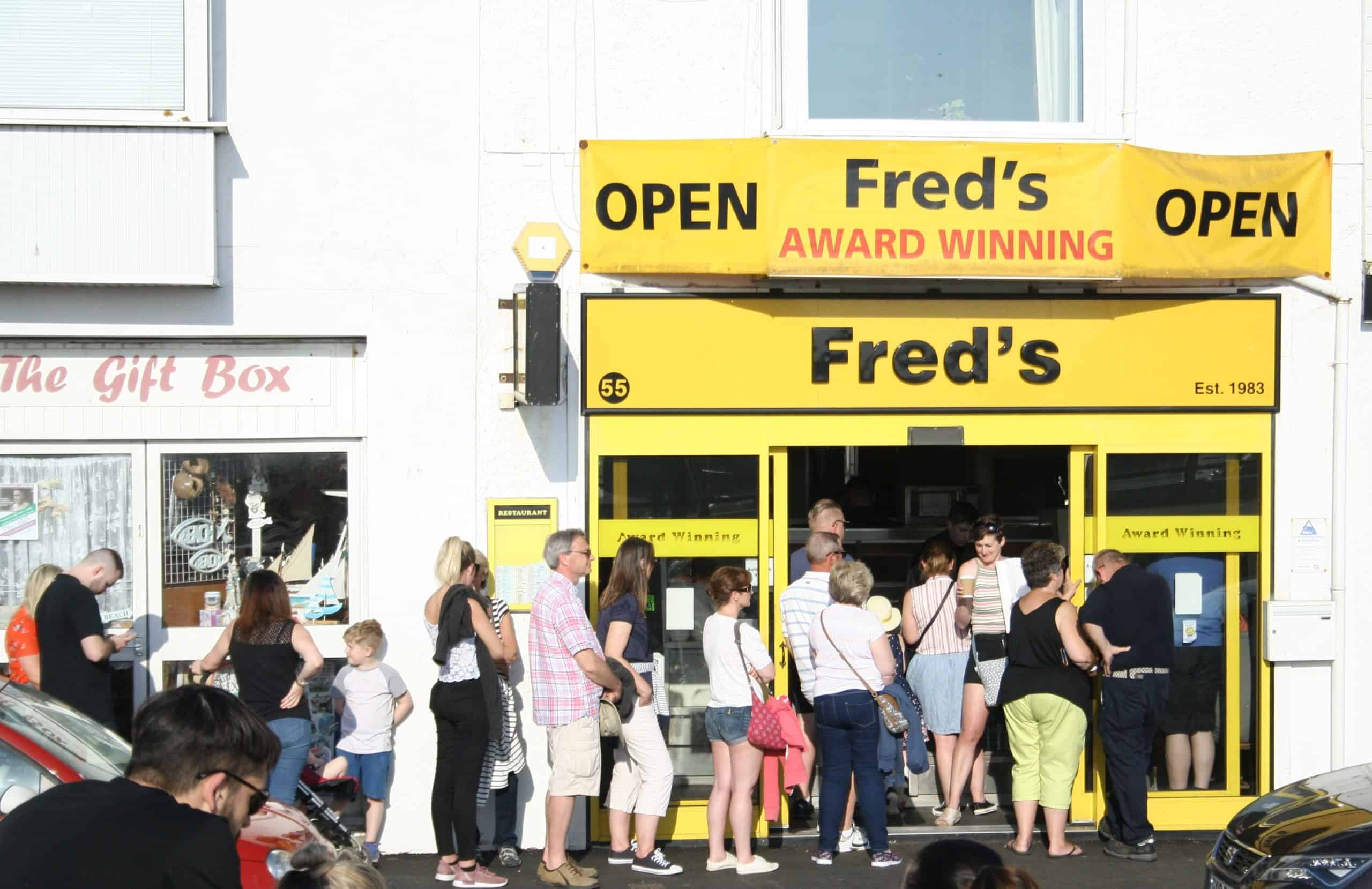 People queuing outside a store